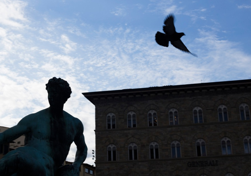 A pigeon flies off the head of a statue at Piazza Signoria on Feb. 13, 2017.